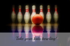 photo of bowling pins and ball